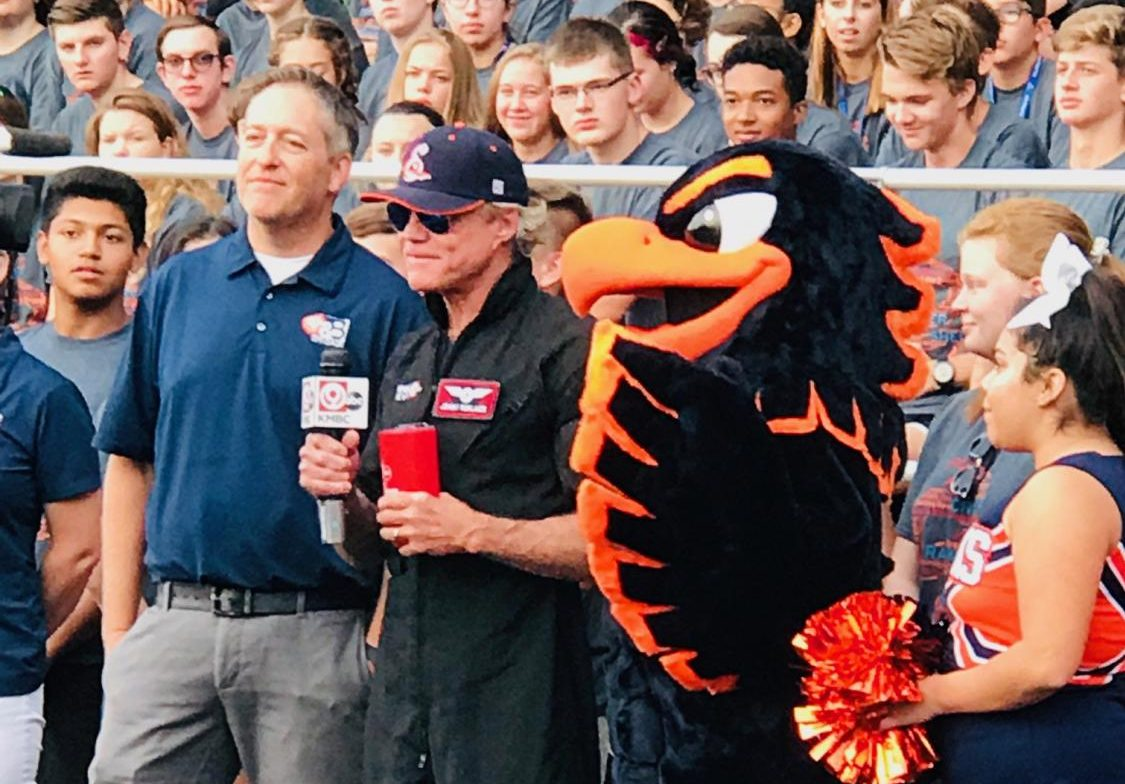 KMBC's Johnny Rowlands meets Olathe East's mascot and OE staff and students on Aug. 20