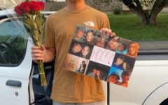 Junior Ben Carter holds up his homecoming proposal to junior Maddie McCord. photo courtesy of maddie mccord